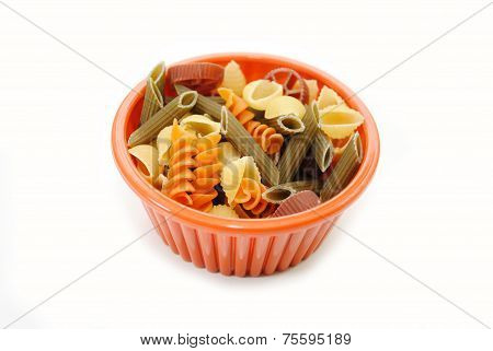 Orange Bowl With Fancy Pasta Isolated On White