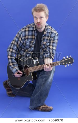 Man Poses With Guitar