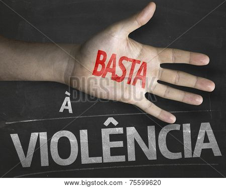 Educational and Creative composition with the message Stop Violence (Portuguese: Contra a Violencia) on the blackboard