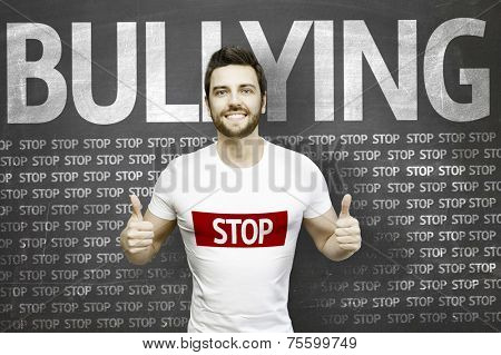 Campaign against Bullying by a man on blackboard background