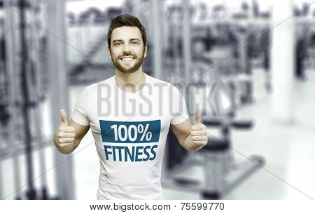 Campaign 100% Fitness by a man on the gym