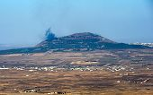 stock photo of golan-heights  - Explosions from the war in Syria can be seen from a hill on the Golan Heights 150 meter from the border about 10 kilometers south - JPG