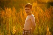 pic of beatitudes  - Boy in shorts standing among tall grass - JPG