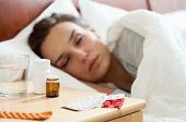 picture of lie  - Woman lying in bed having autumn flu - JPG