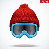 picture of knitted cap  - Knitted woolen red cap with snow ski goggles - JPG