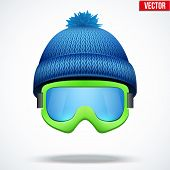 picture of knitted cap  - Knitted woolen blue cap with snow ski goggles - JPG