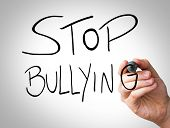 foto of stop bully  - Hand writing with black and blue marker on transparent wipe board  - JPG