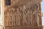 stock photo of bible story  - Bible stories in the sculpted frieze of Armenian Church of the Holy Cross on Akhtamar Island  - JPG