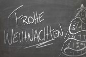 pic of weihnachten  - Christmas tree on blackboard and the text Frohe Weihnachten  - JPG