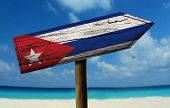 stock photo of bandeiras  - Cuba wooden sign with a beach on background  - JPG