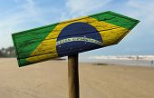 picture of bandeiras  - Brazil flag wooden sign with a beach on background  - JPG