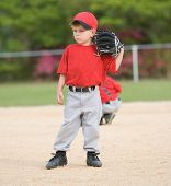 foto of little-league  - Little League baseball player standing on infield - JPG