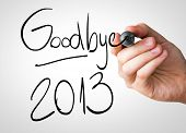 foto of bye  - Goodbye 2013 hand writing with a black mark on a transparent board - JPG