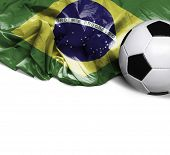 image of bandeiras  - Waving flag of Brazil and a soccer ball - JPG