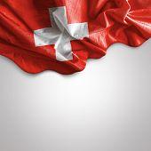 stock photo of zurich  - Waving flag of Switzerland - JPG
