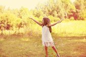 picture of have sweet dreams  - Positive little girl having fun soap bubbles - JPG