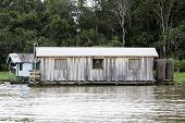 stock photo of negro  - Floating houses in Manaus - JPG