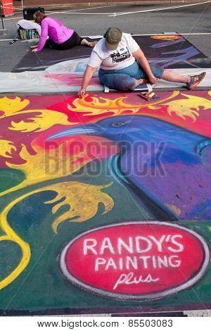 Chalk Artist Sketches Halloween Scene On Street