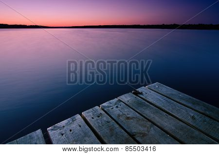 Wooden Bridge And Beautiful Twilight On The River In Summer