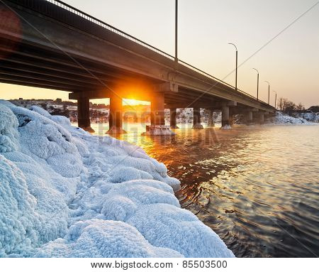 Snowy Bridge And Beautiful Frosty Sunset On The River In Winter