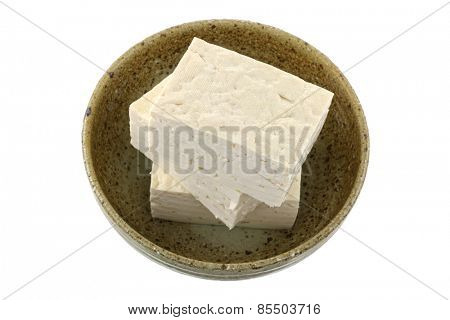 Closeup photography of fresh Japanese Momen (cotton) tofu, isolated on white