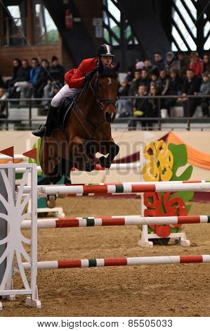 KAPOSVAR, HUNGARY - MARCH 15: Tamas Mraz jumps with his horse (Basco) on the Masters Tournament International Jumping Competition, March 15, 2015 in Kaposvar, Hungary
