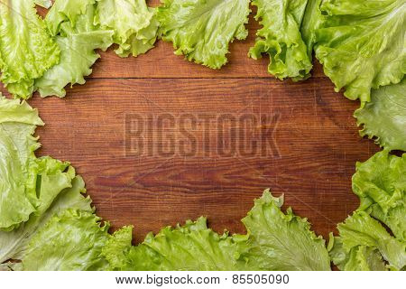 Frame of salad on old wooden table