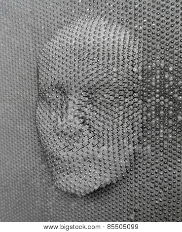 close up of human face concept made from pin board toy