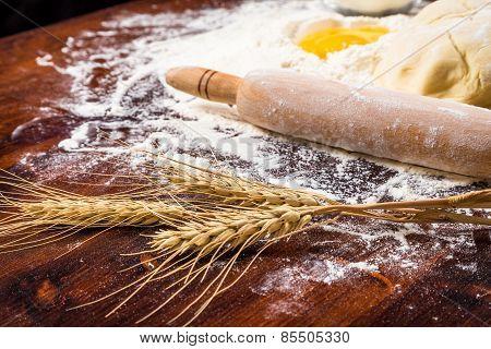 Flour, ear and egg on table