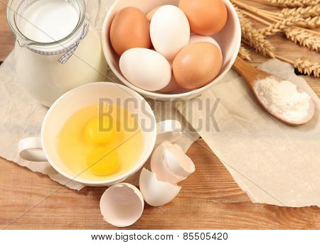 Eggs and meal on wooden table