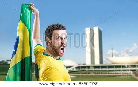 Man holding the Brazilian flag in Brasilia, Brazil