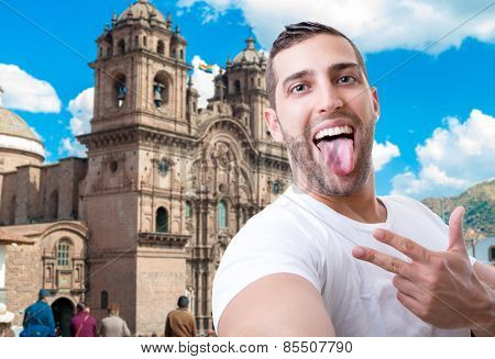 Happy young man taking a selfie photo in Cuzco, Peru