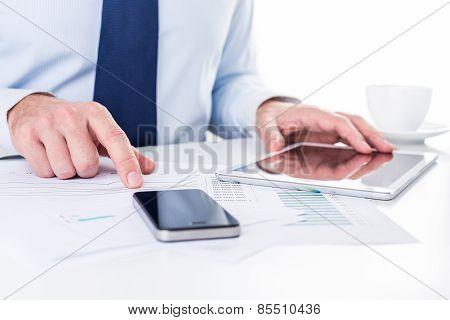 Businessman working on a digital tablet.