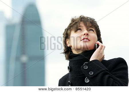 Woman In Black Talking On Mobile