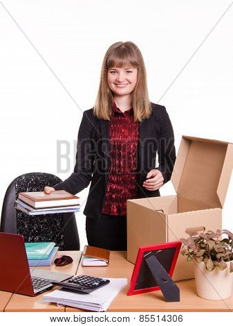 New Employee In The Office Arranges Personal Belongings