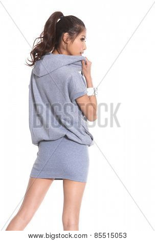 back view of standing young beautiful woman in shorts.