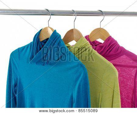 Three female clothing on hangers