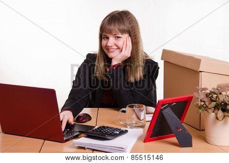 Smiling Girl Sitting In Office At Computer