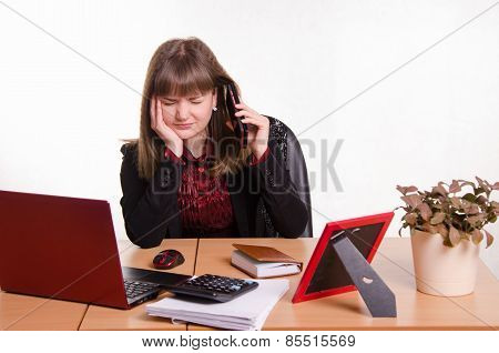 Girl Behind Office Desk Listening To Cry Of The Phone