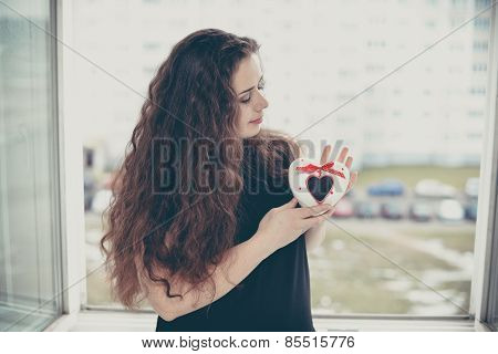 Pretty Woman In Love Holding Heart-shaped Box