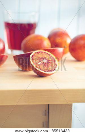 halved blood orange on kitchen table