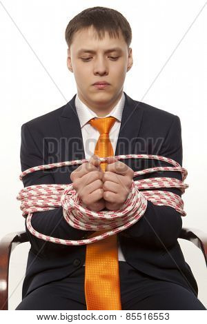 Businessman with hands tied in ropes. Business problems and difficulties
