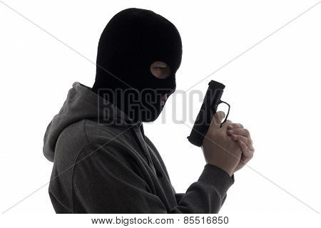 Dark Silhouette Of Burglar Or Terrorist In Mask Holding Gun Isolated On White
