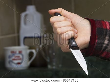 Girl's Hand With A Knife