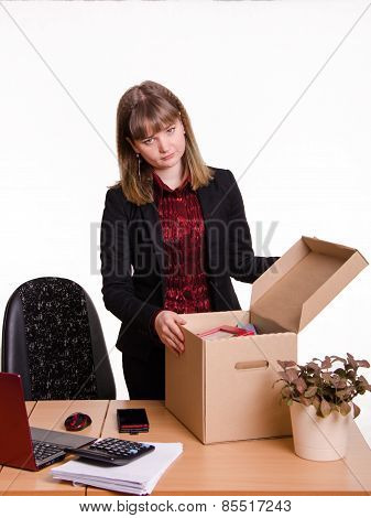 Dismissed Girl In Office Near Table Collects Personal Belongings A Box