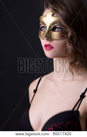 Close Up Portrait Of Beautiful Woman In Lingerie And Mask Over Grey
