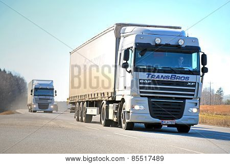 Two White DAF XF Semi Trucks On The Road