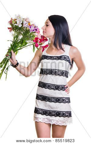 Beautiful Woman With A Bouquet Of Colorful Flowers