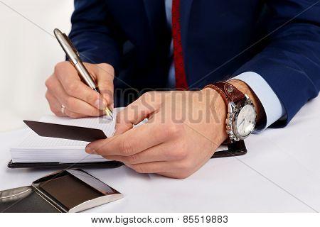 Businessman holding a business card.
