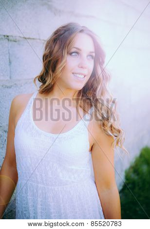 Cool pretty woman lit with white dress and a beautiful smile